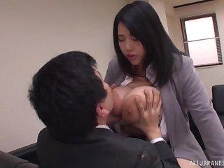 Chubby Japanese secretary Yuuki Iori gives a tijob with her huge tits