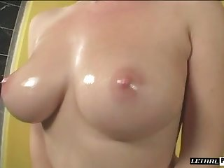 All lubed buxom hottie is happy to suck delicious long black cock