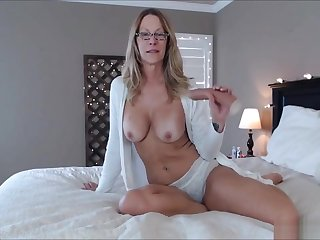 Older woman wearing that sexy teacher glasses and playing naughty in her bathrobe!