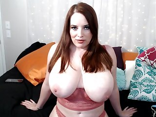 Cougar Maggie Green plays with her massive juggs and pussy