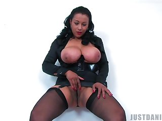 Horny mature Danica Collins enjoys playing with her large boobs